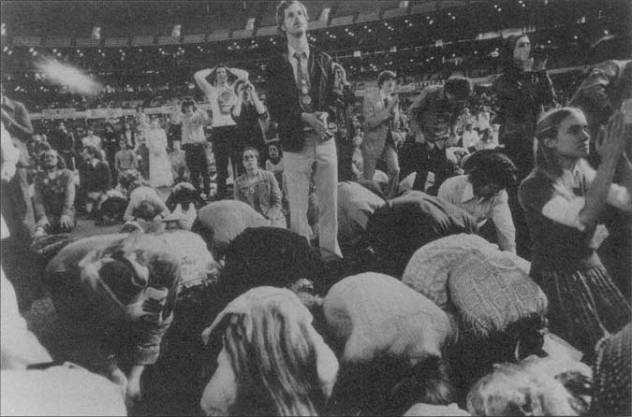 Followers praying in the Astrodome