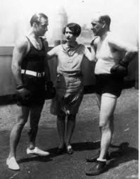 To avenge an insult to his manhood, Rudolph Valentino takes on boxing writer, Frank O'Neill on the roof of a hotel. Valentino won on points. 1920s.