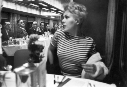 Kim Novak can feel the eyes upon her.