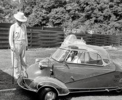 Elvis in a mini car. 1957.