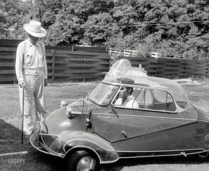 Elvis in a mini car. 1957.