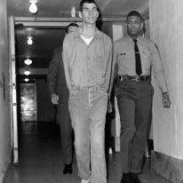 Tex Watson taken back to jail.