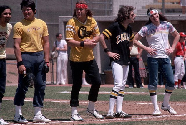 May 1978 --- Glenn Frey and Timothy B. Schmit of the Eagles, stand in the field during a charity baseball game hosted by the Eagles.  The Eagles were the most popular band of the seventies and their reunion tour in the nineties was also very successful. --- Image by © Henry Diltz/CORBIS